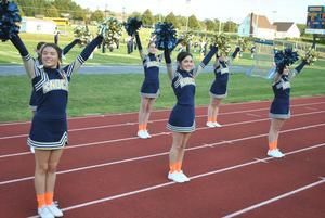pic of cheerleaders wearing orange socks and ribbons