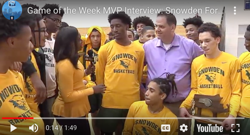 Students are interviewed after basketball game