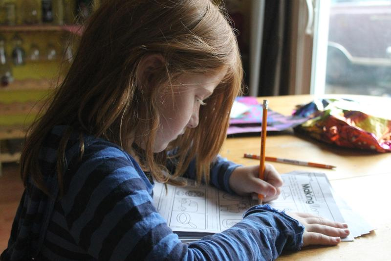 Girl working on writing worksheet