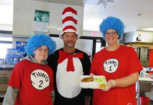 McFall Principal Jon Washburn joins the lunchroom crew as they dress up like Dr. Seuss' characters sto serve green egss and ham.