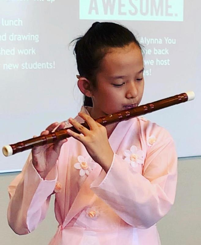 Exchange student playing the flute.