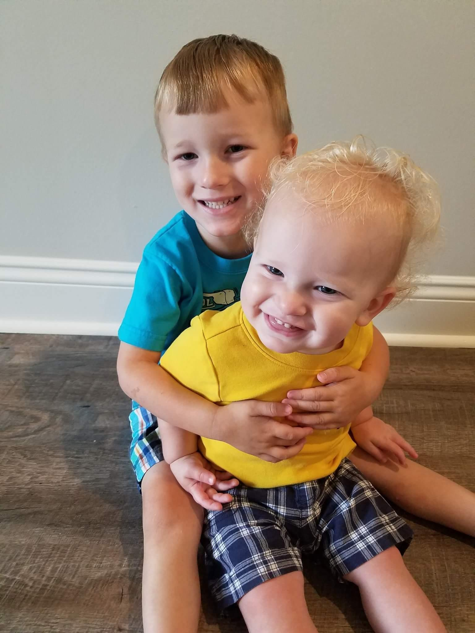 My two grandsons hugging each other