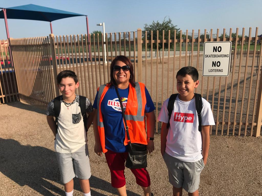 Principal Dunker with students