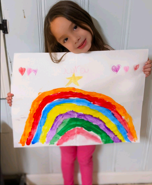 Girl holding painting of rainbow