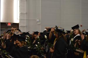 Seniors move their tassels after being declared graduates.