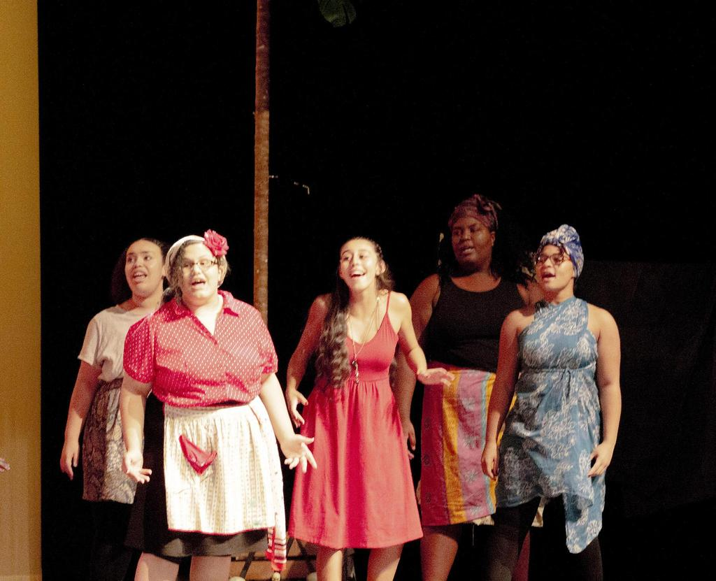 """Five cast members sing a song during the musical, """"Once On This Island"""""""