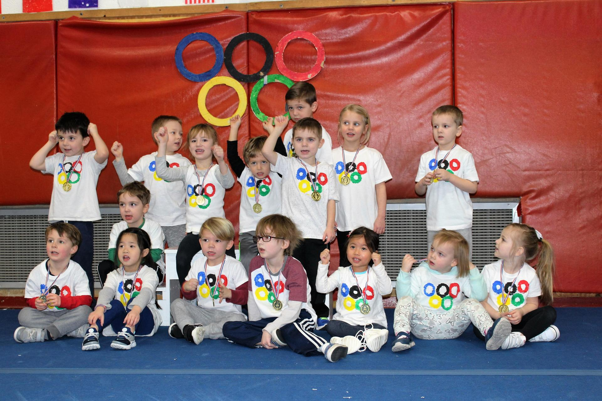 preschoolers sit in Olympics shirts