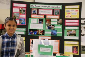 A third grader giving her invention convention project.