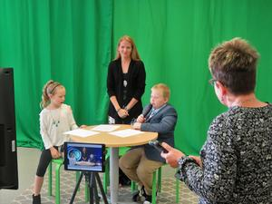 Lee Elementary students prepare a video broadcast of the school news.
