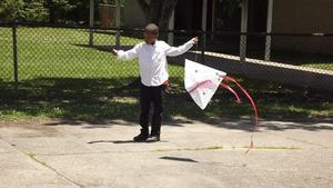 a photo of Park Ridge student preparing to launch his kite in kite flying activity