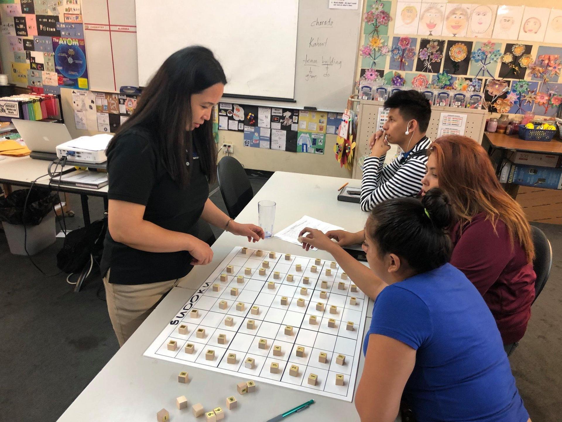 Teacher Anna Legaspi with students