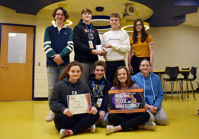 """The team of Mars Area Middle School students, (back row, from left) Nicholas Ferrari, Charlie Bickel, Cooper Courson, Annelie Gustafsson, (front row) Kylie Lavelle, Teo Biaggini, Addison Girdwood, Katelyn McKee and (not pictured) Mira Ramanathan, earned first place in the Best Manufacturing Message category  of the 2020 Pittsburgh Central """"What's So Cool About Manufacturing"""" Student Video Contest."""