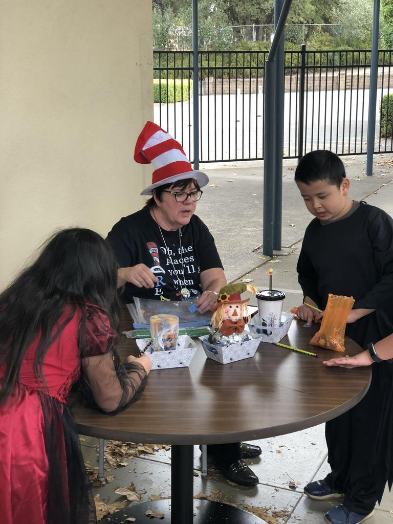 Principal Mrs. Fletcher helping the students during the Fall Carnival