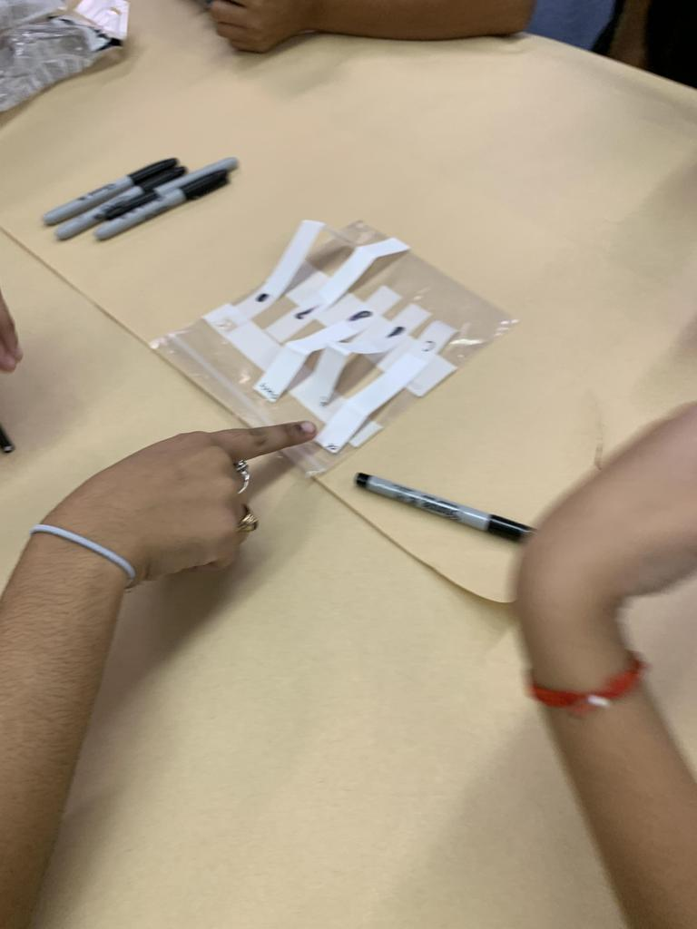 girl pointing to a result strip on the table