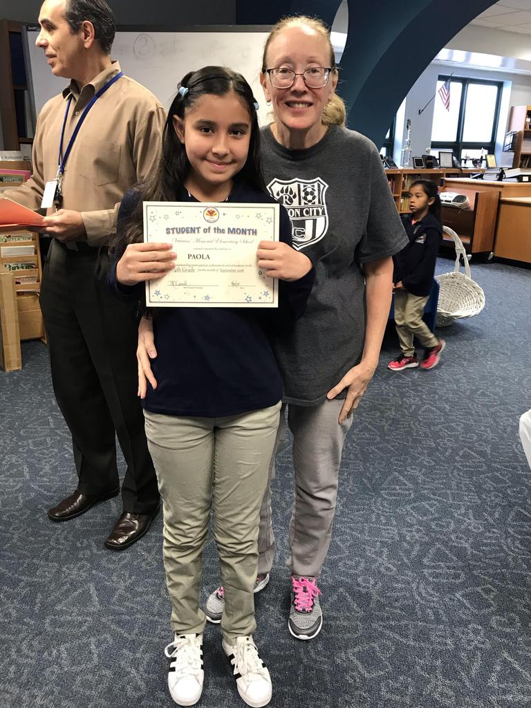 student of the month Paola grade 4 with principal O'connel