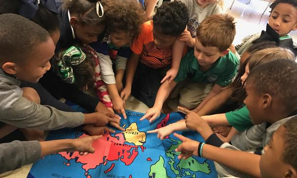 Mrs. Thomas' first grade class finding Africa on the map after reading an African folk tale,