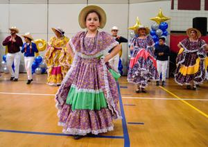 Folkloric dance groups from Foster and Walnut elementary schools, as well as the District's group, perform for audience members on March 2 during the District Showcase.