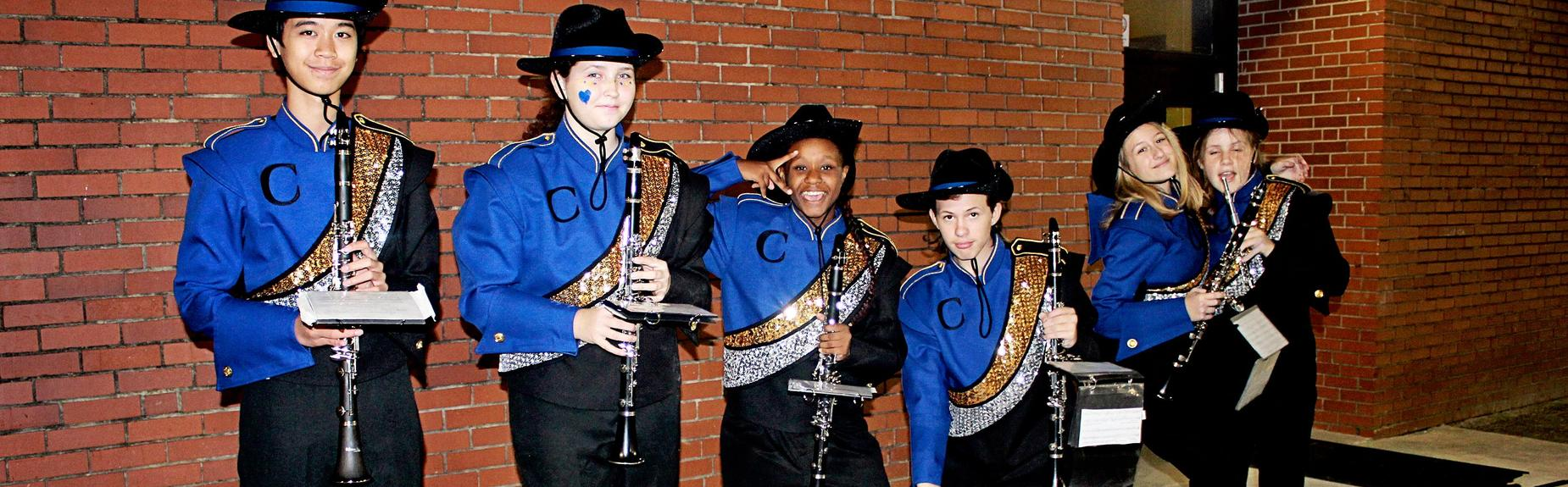band students holding instruments and smiling