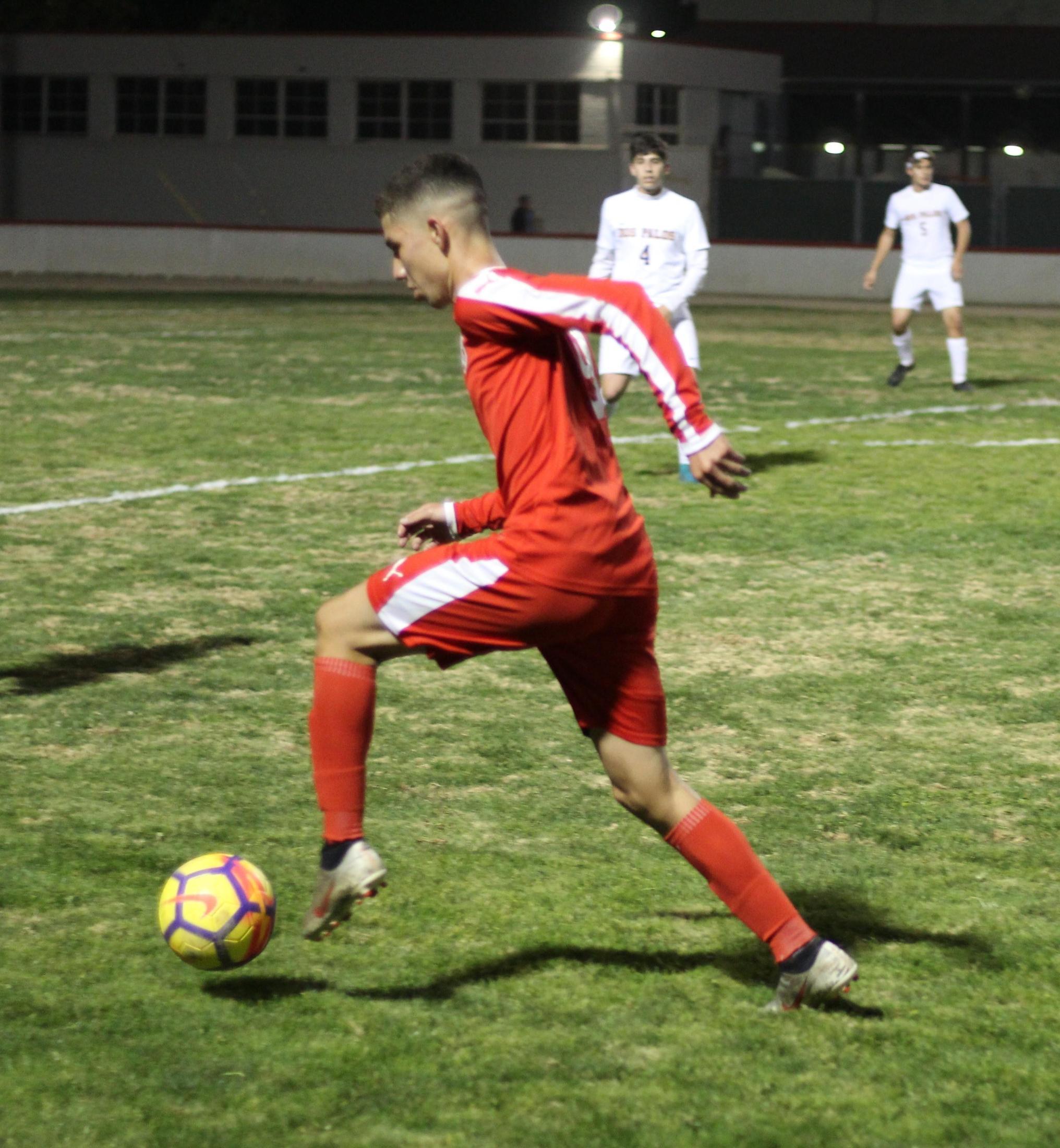 Jose Renteria with the ball