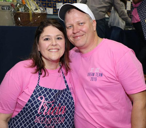 man and woman in pink shirts smiling