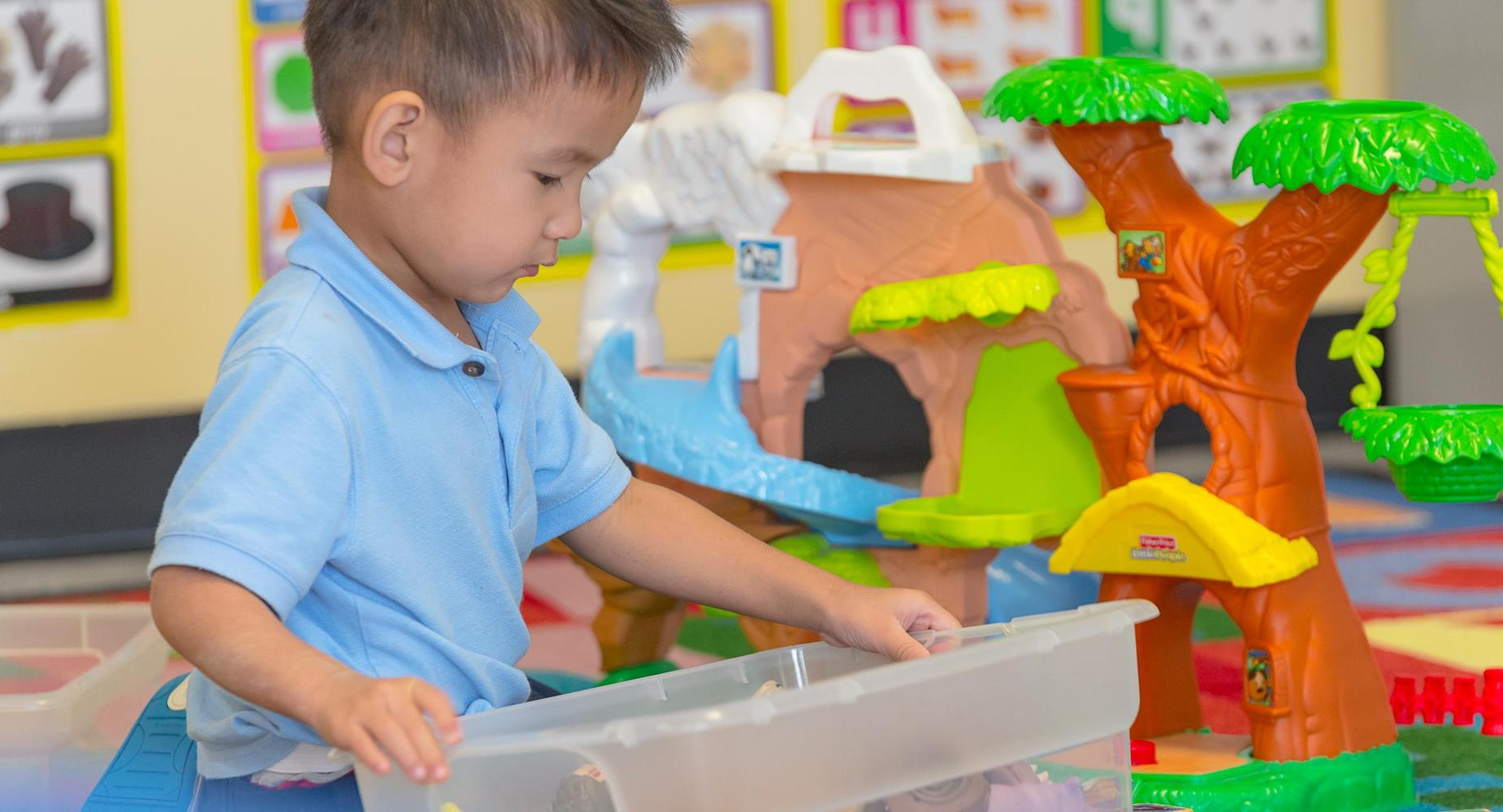 Preschool student playing with toys