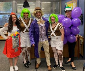 Photo of principal David Duelks and front office staff dressed as Willy Wonka and characters