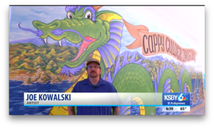 Artist Joe Kowalski with the new Dragon Mural at Cappy Culver