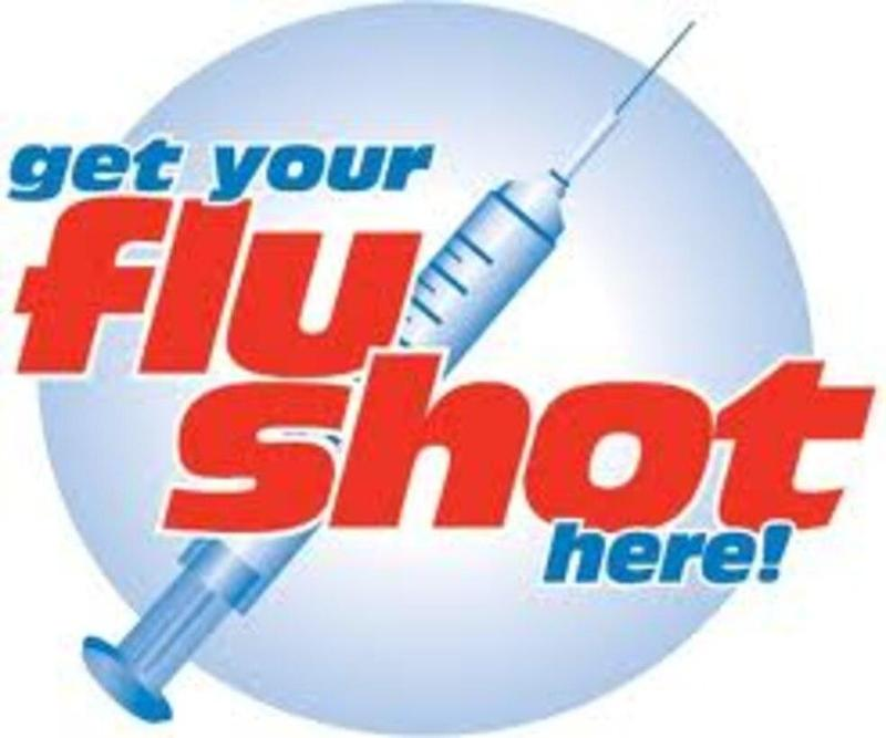 a shot with the words flu shot written around it
