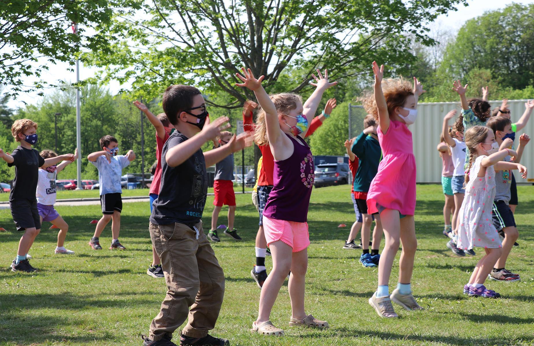 Children dancing outside