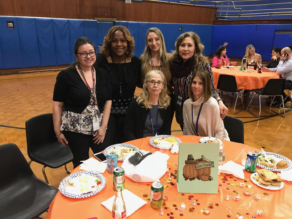 Edison teachers and staff posing at the thanksgiving luncheon