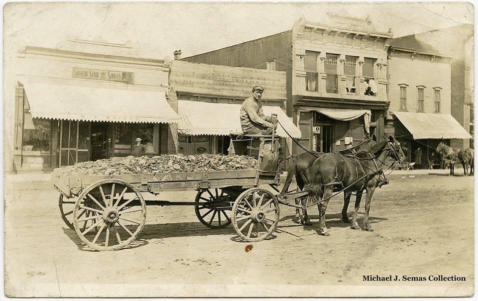 historical exeter- man with horse drawn carriage