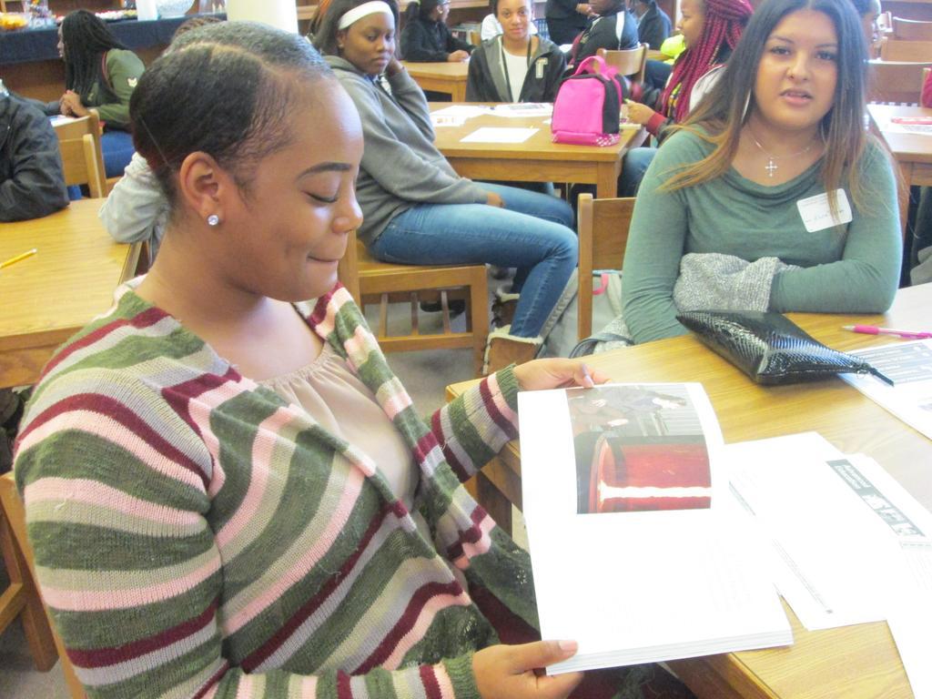 Student looks through author Stephanie Espy's book.