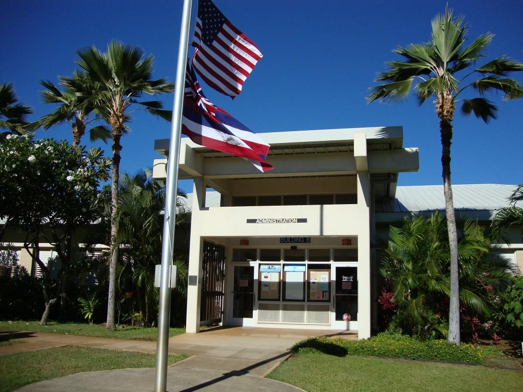 Makalapa Office with palm trees and the American Flag