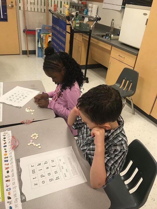 Kindergarten students counting with Smarties