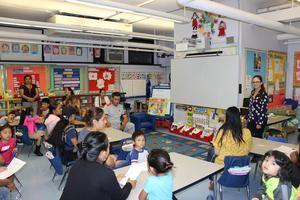 kindergarten teacher addressing new parents