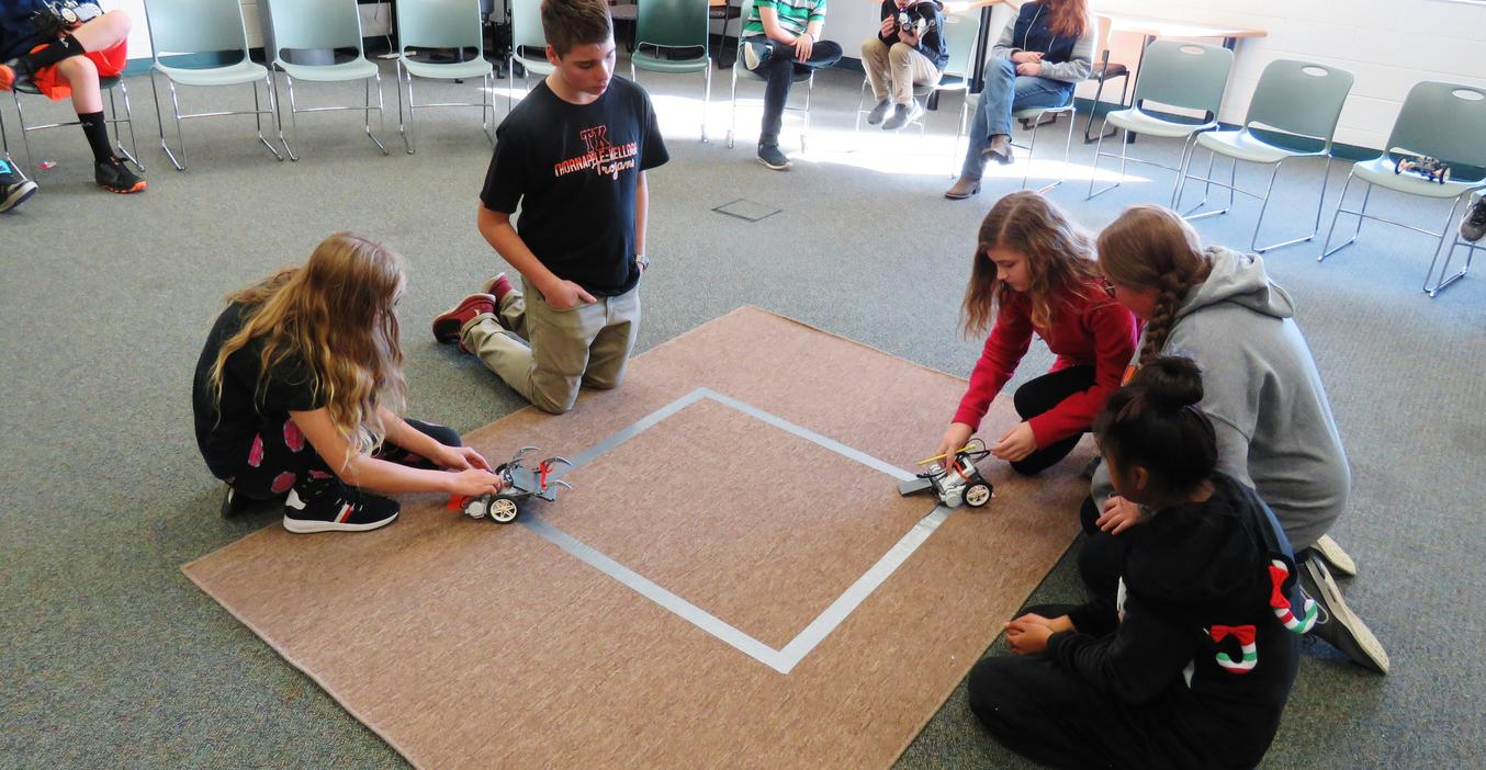 Students prepare their robots for the