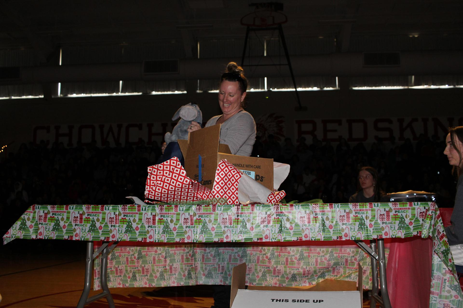 Mrs. Harrel opening her gift