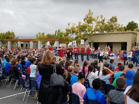 "BC students and staff hold up the letters BCES during the ""BCES"" song."