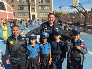 two girls and three boys dressed as police officer with UC finest