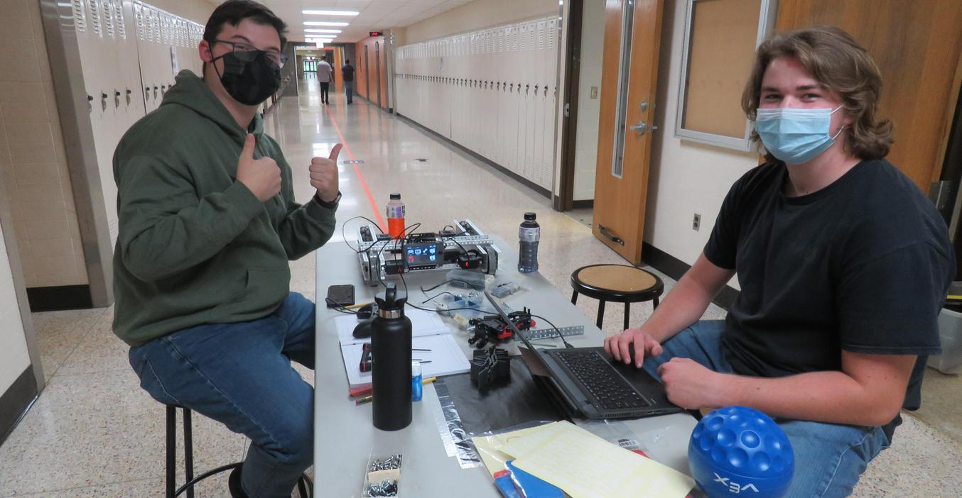 TKHS robotics students work on building and programming their robots.