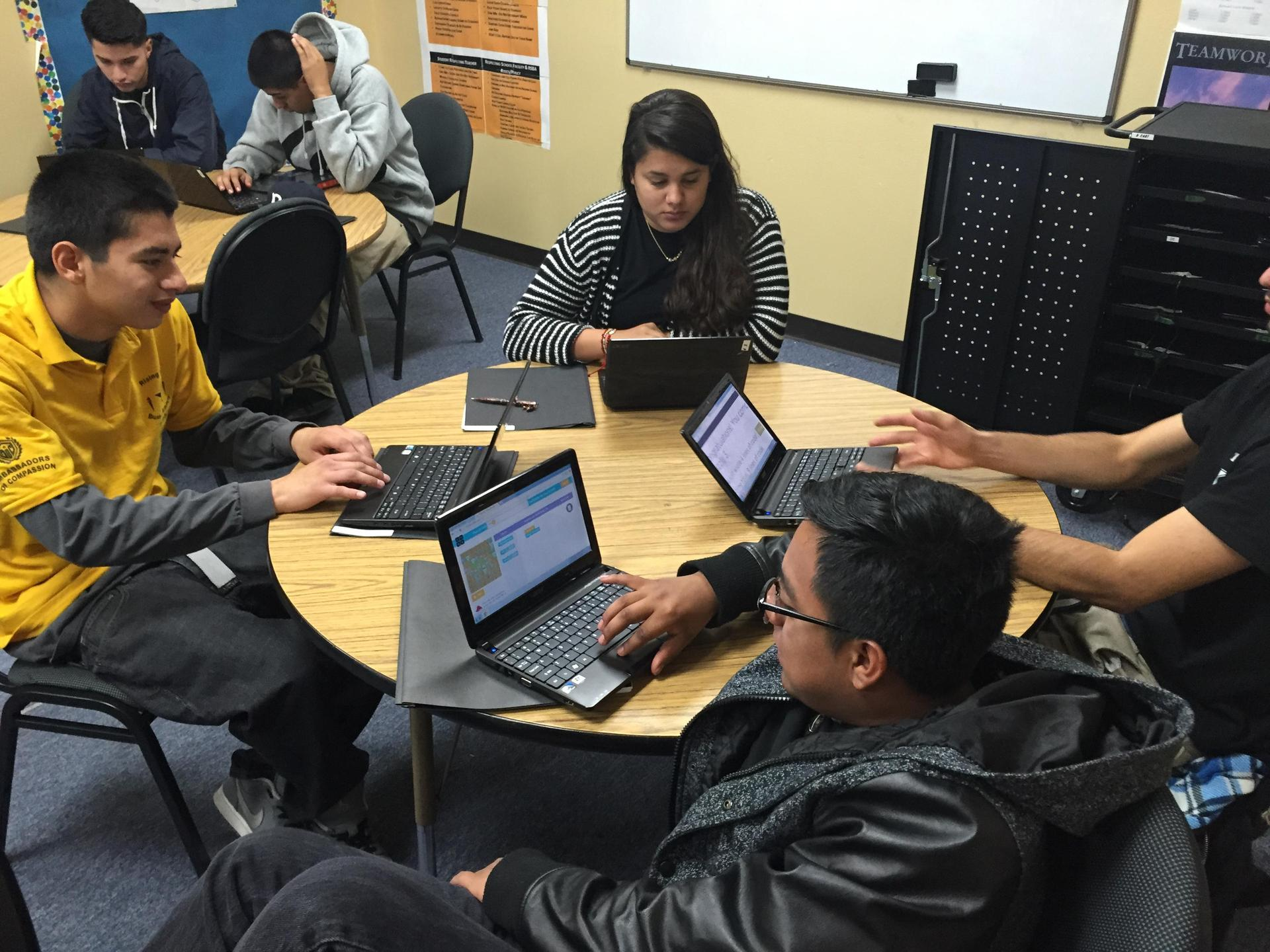 Moreno Valley students coding on laptops