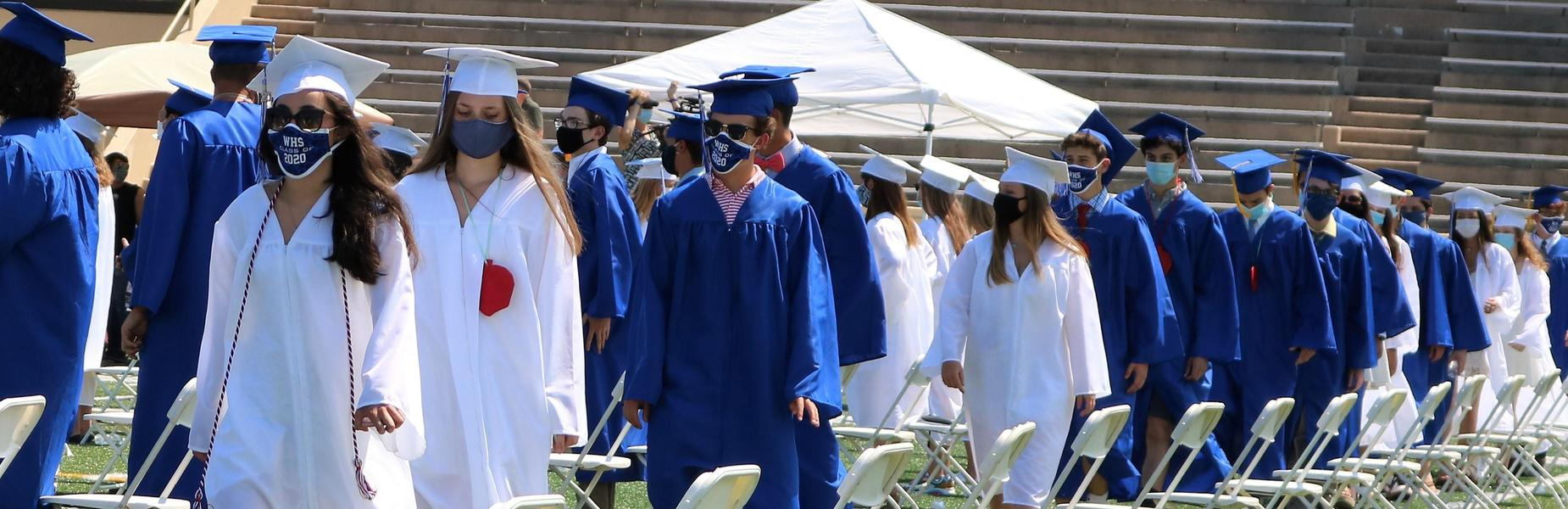 Photo of WHS graduates progressing in for ceremony.
