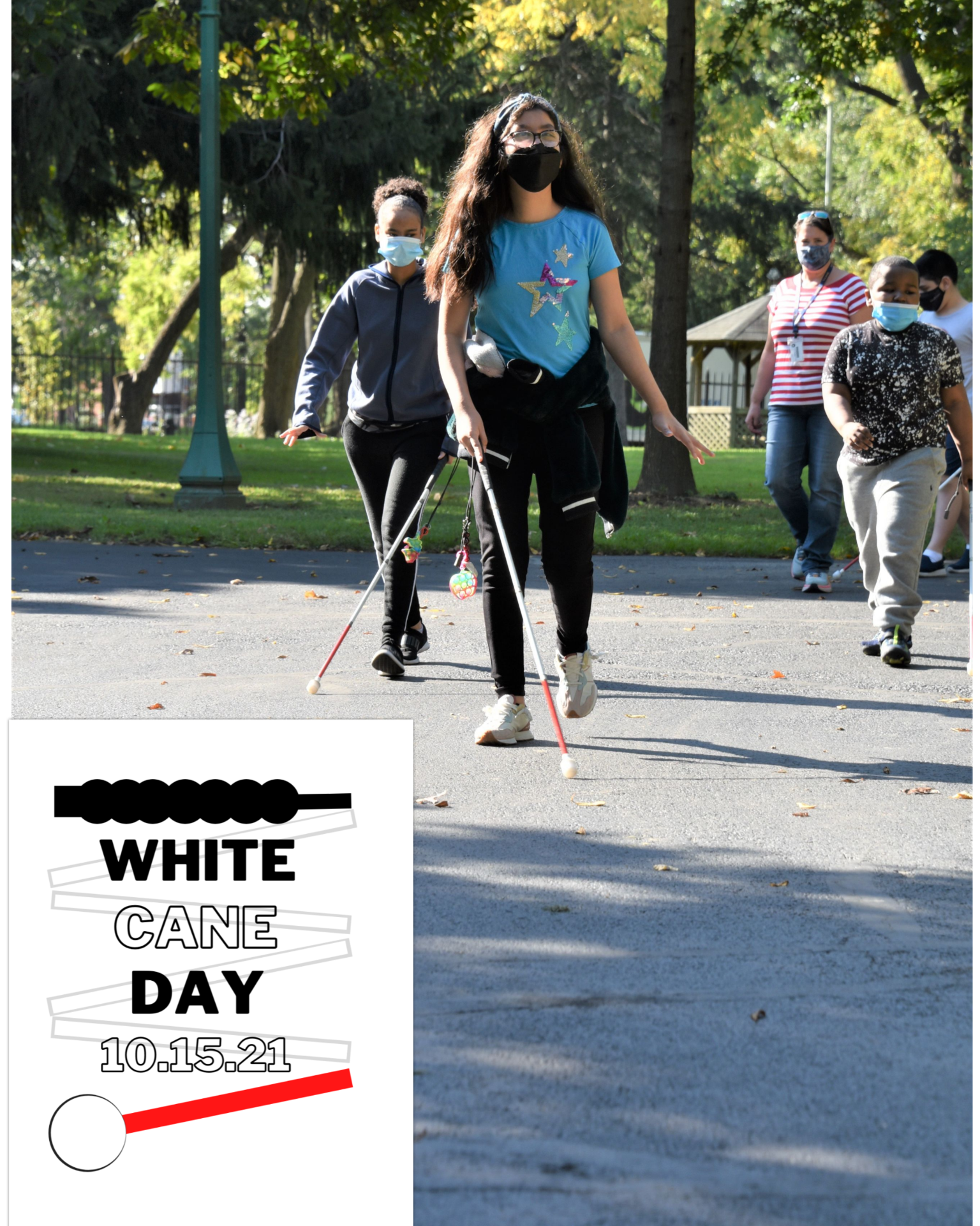 Students are walking down the path with their White Canes