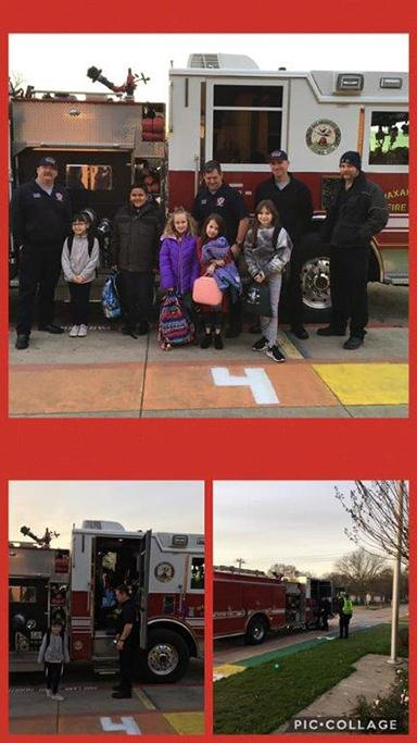 Northside Elementary students pose with firefighters and firetruck