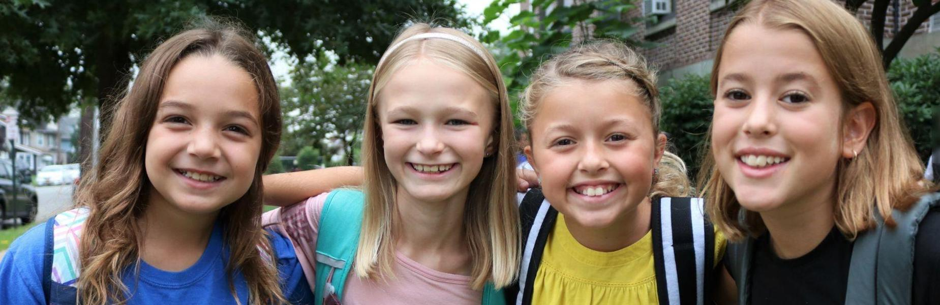 McKinley students smile widely on 3rd day of new school year.