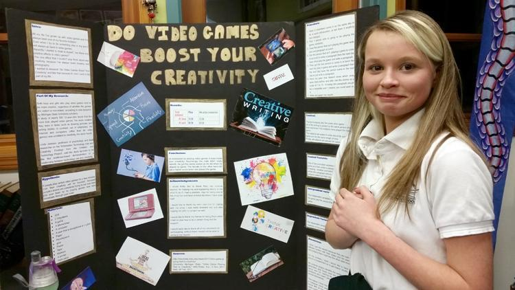 Girl with science project poster