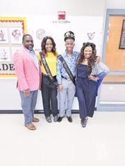 Administration posing with Sammie Cornelius (RIP) Homecoming King & Queen