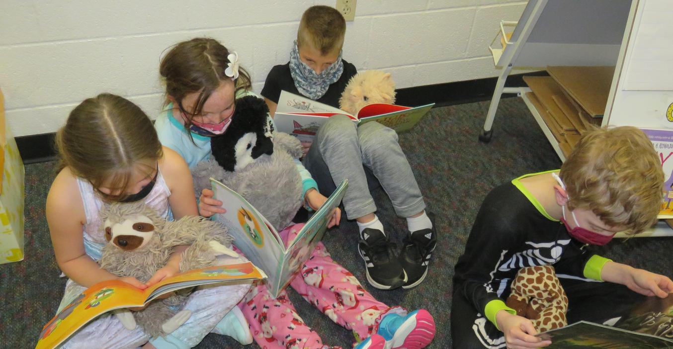 Students enjoy reading with their stuffed animals.