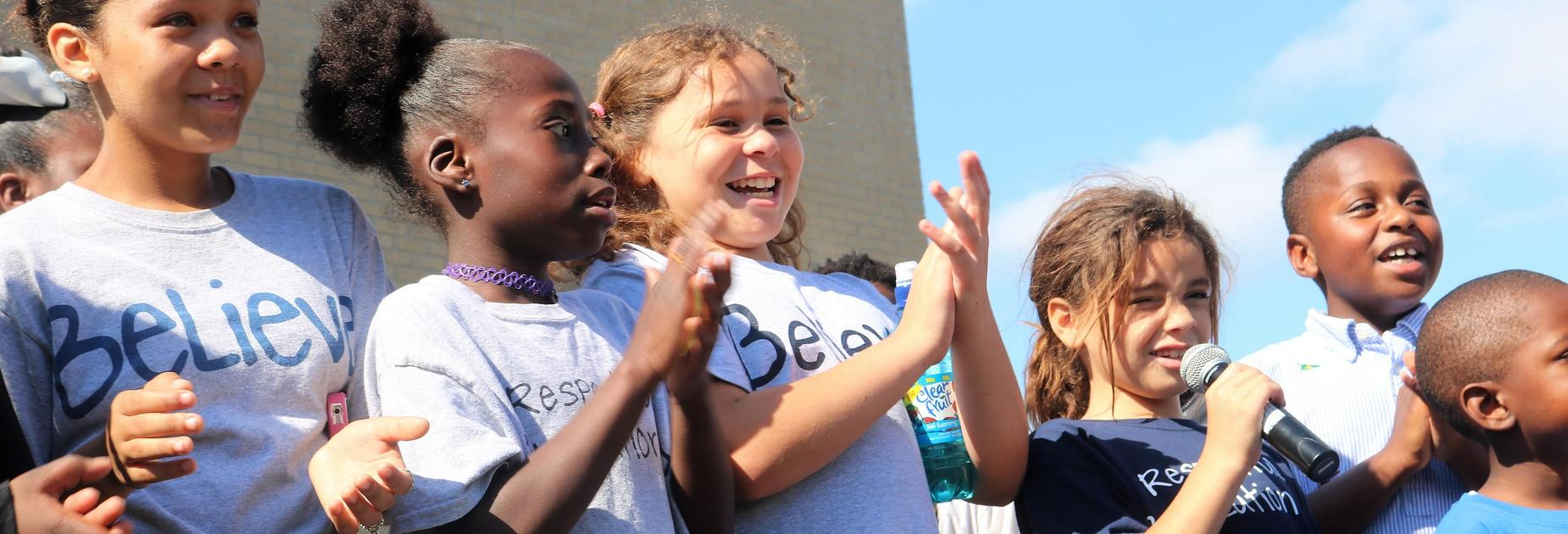 KIPP Believe students singing at the groundbreaking