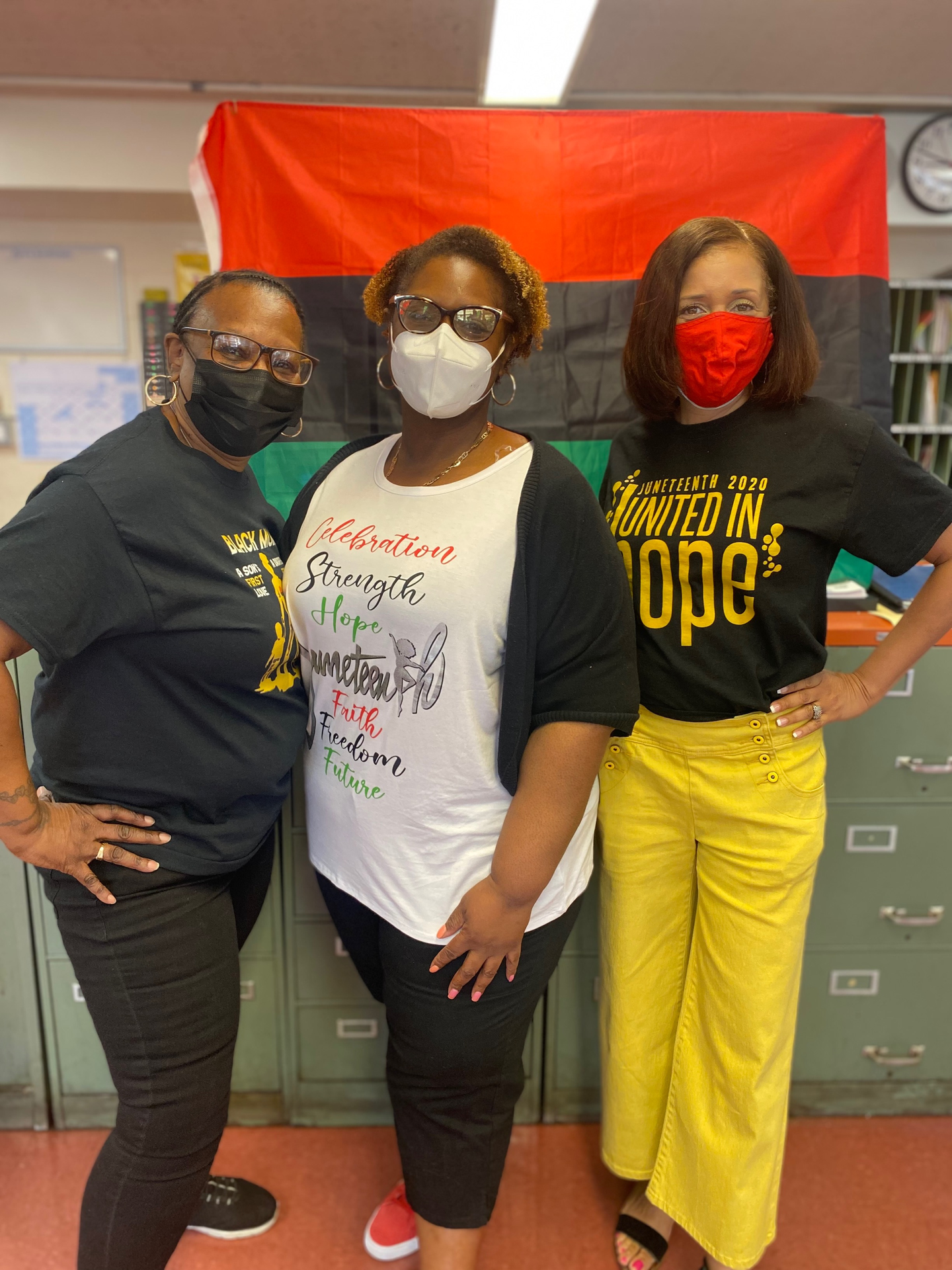 Ms. Bell, Ms. Marshall, and Dean Bratton representing Juneteenth colors!